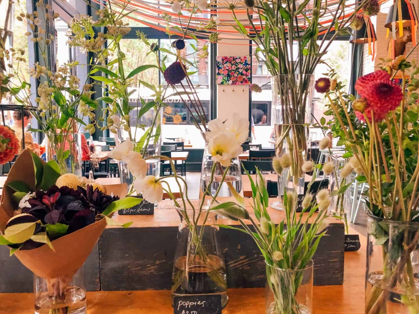 flowers and streamers adorning the inside of a restaurant