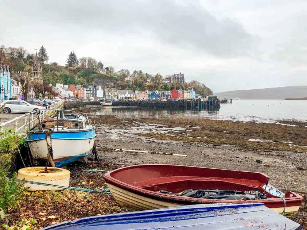 Rainbow colored boats along the Scottish coastline