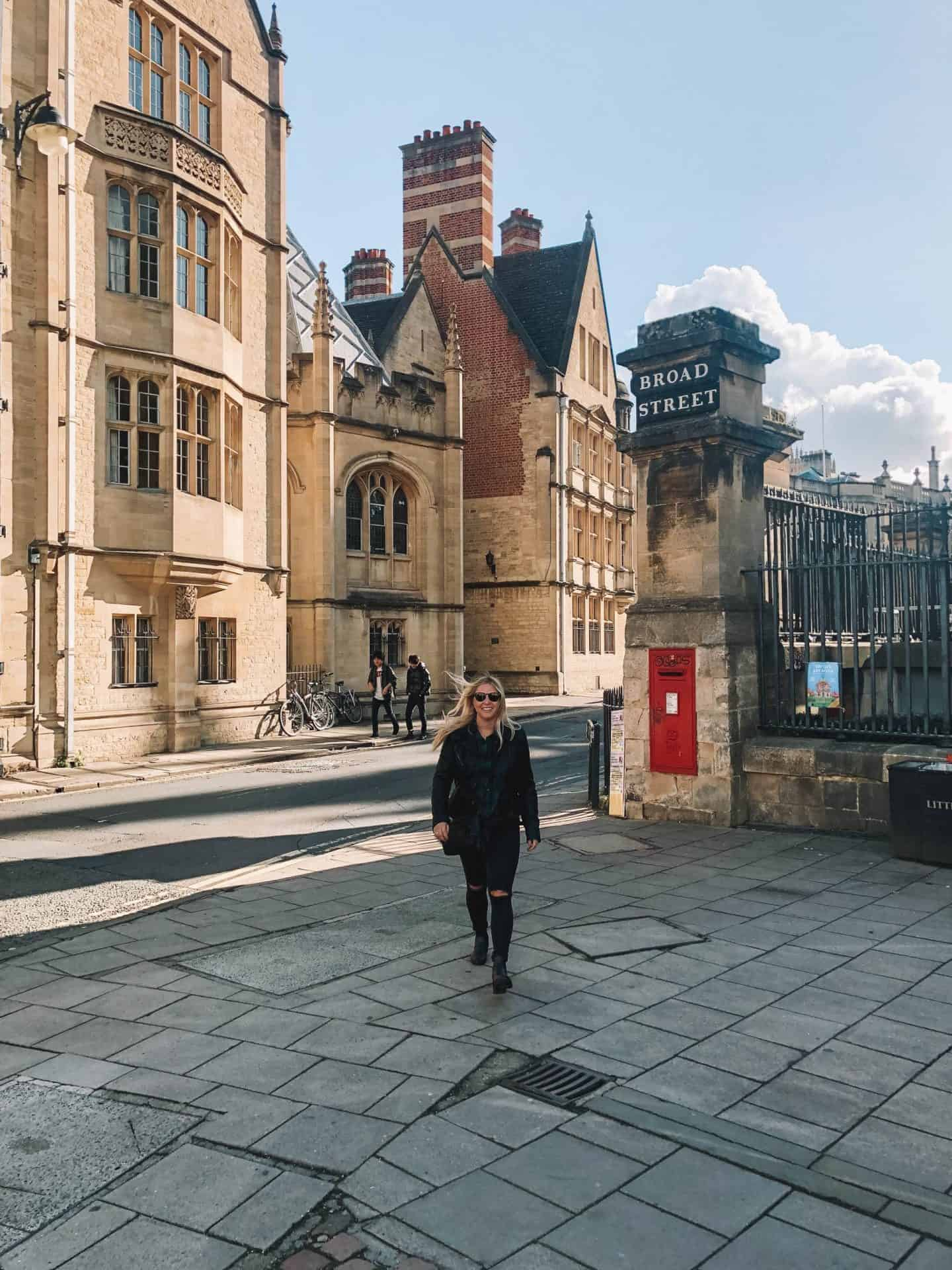 Girl smiling, walking towards the camera in historic Oxford