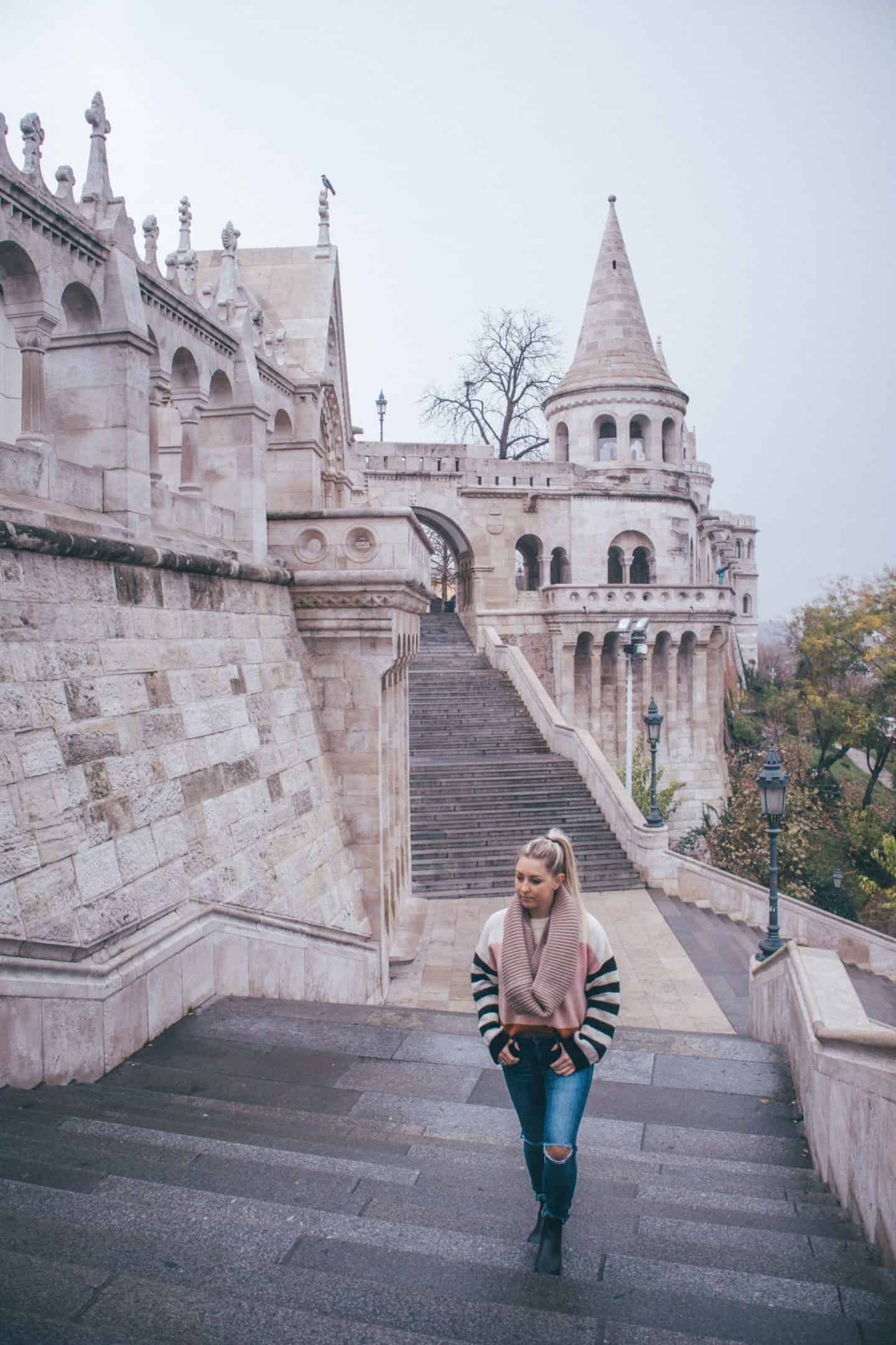 girl walking with fisherman's bastion in background