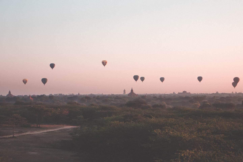 hot air balloons over ancient pagodas