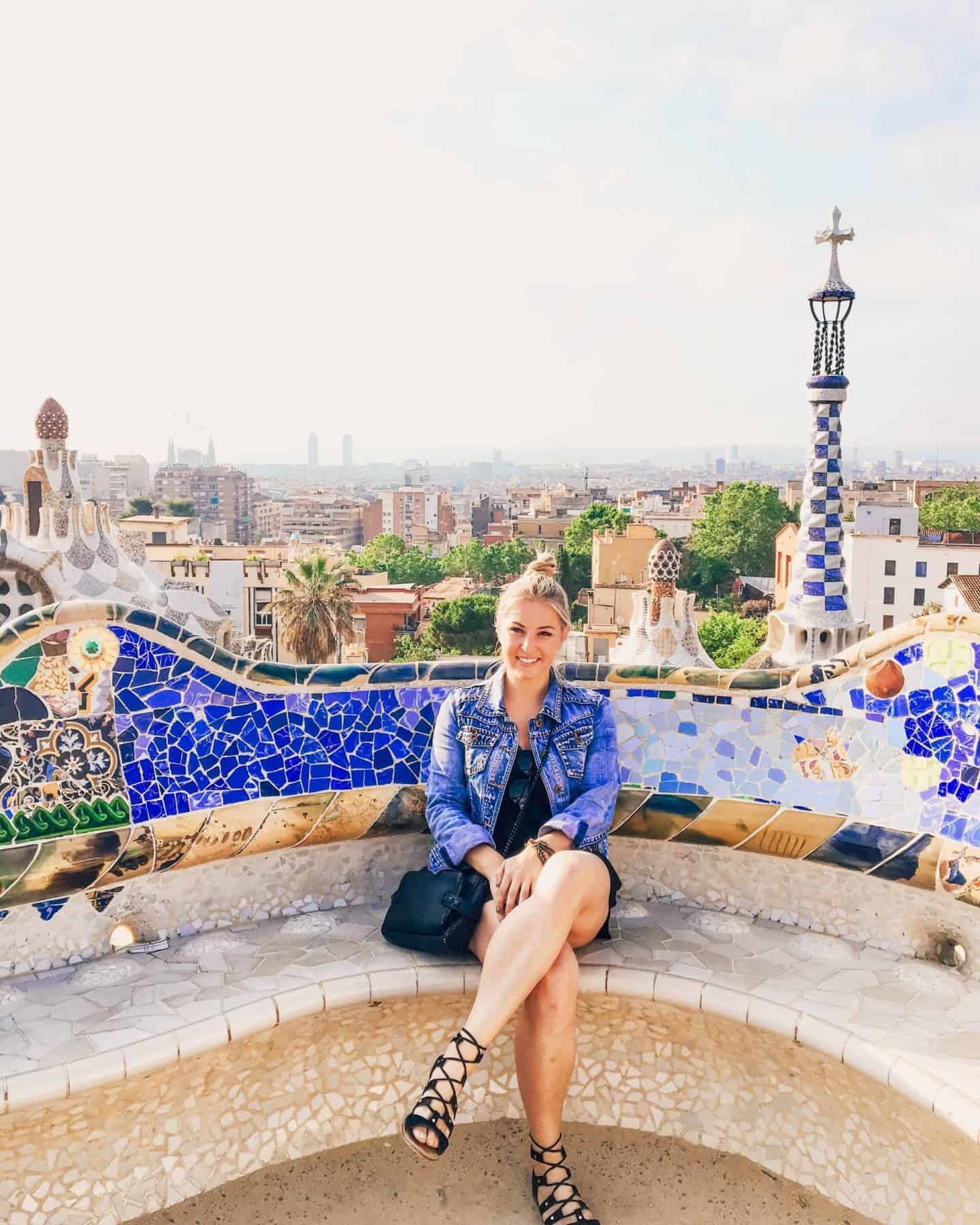 colorful view of barcelona from the longest bench in the world at parc guell
