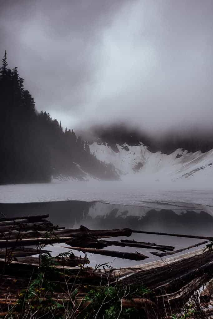 misty and foggy view of lake serene before the sun rises