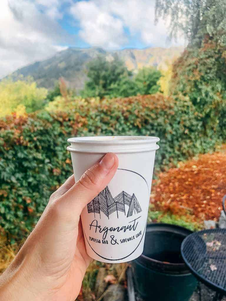 coffee cup with mountainous backdrop