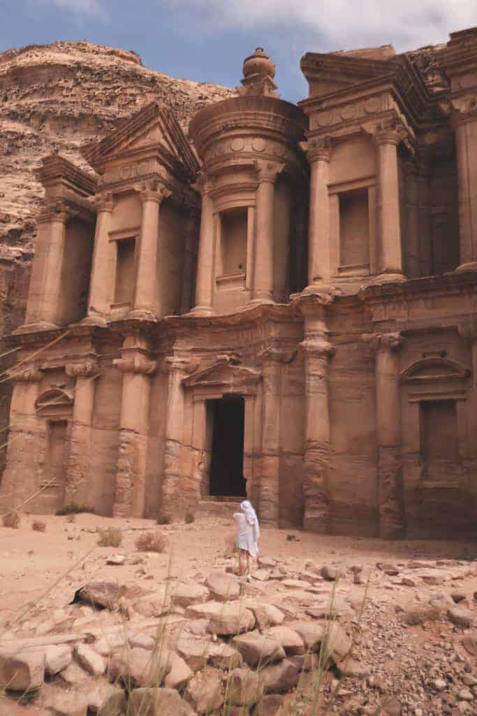 standing in front of the montastery at petra - one of the 7 wonders of the world