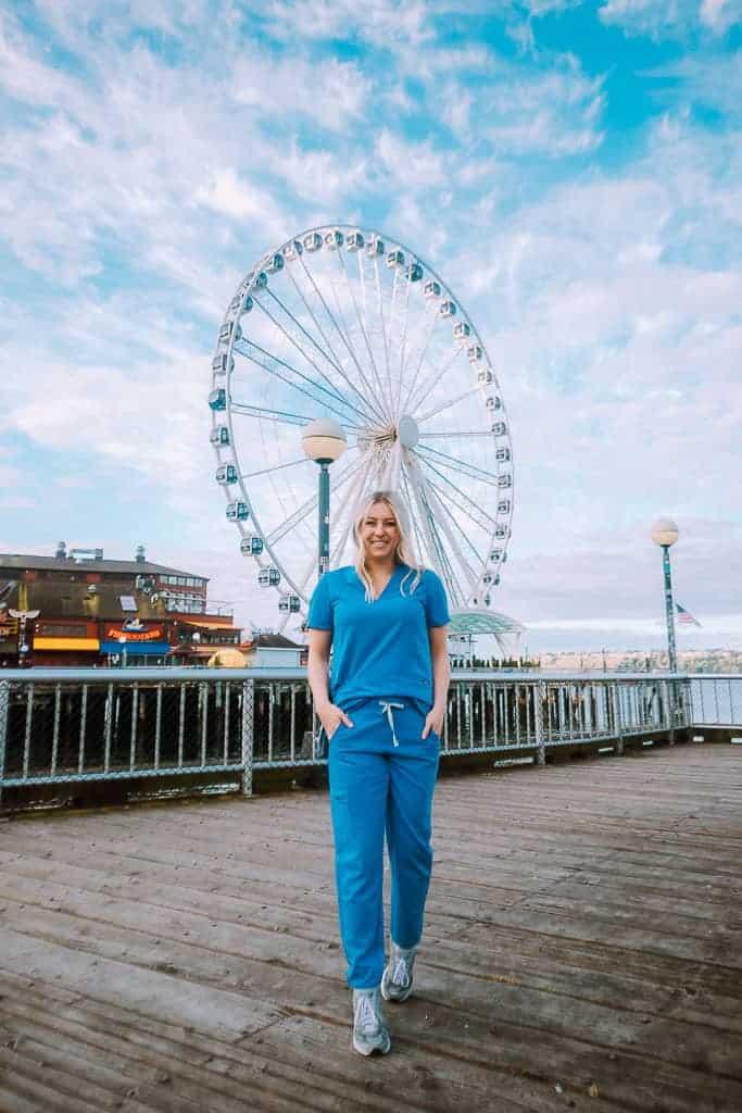 nurse in front of ferris wheel