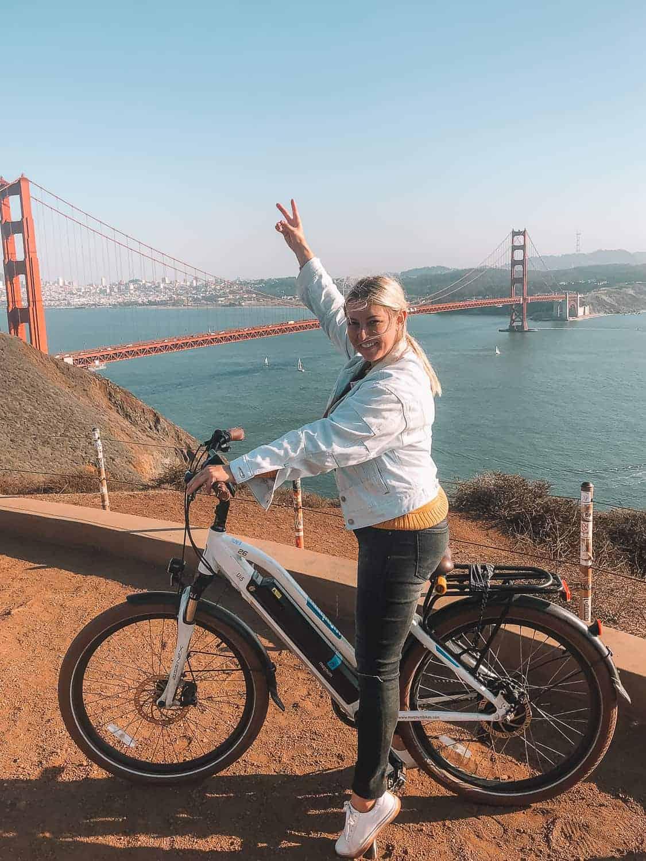 girl on bike in front of golden gate bridge