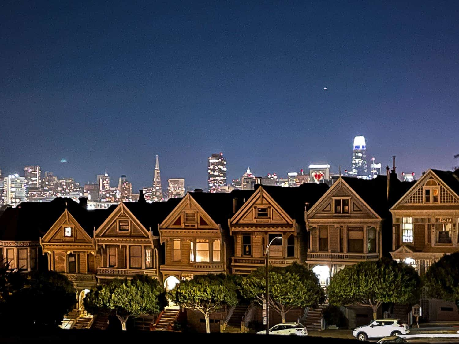the painted ladies and san francisco skyline at night