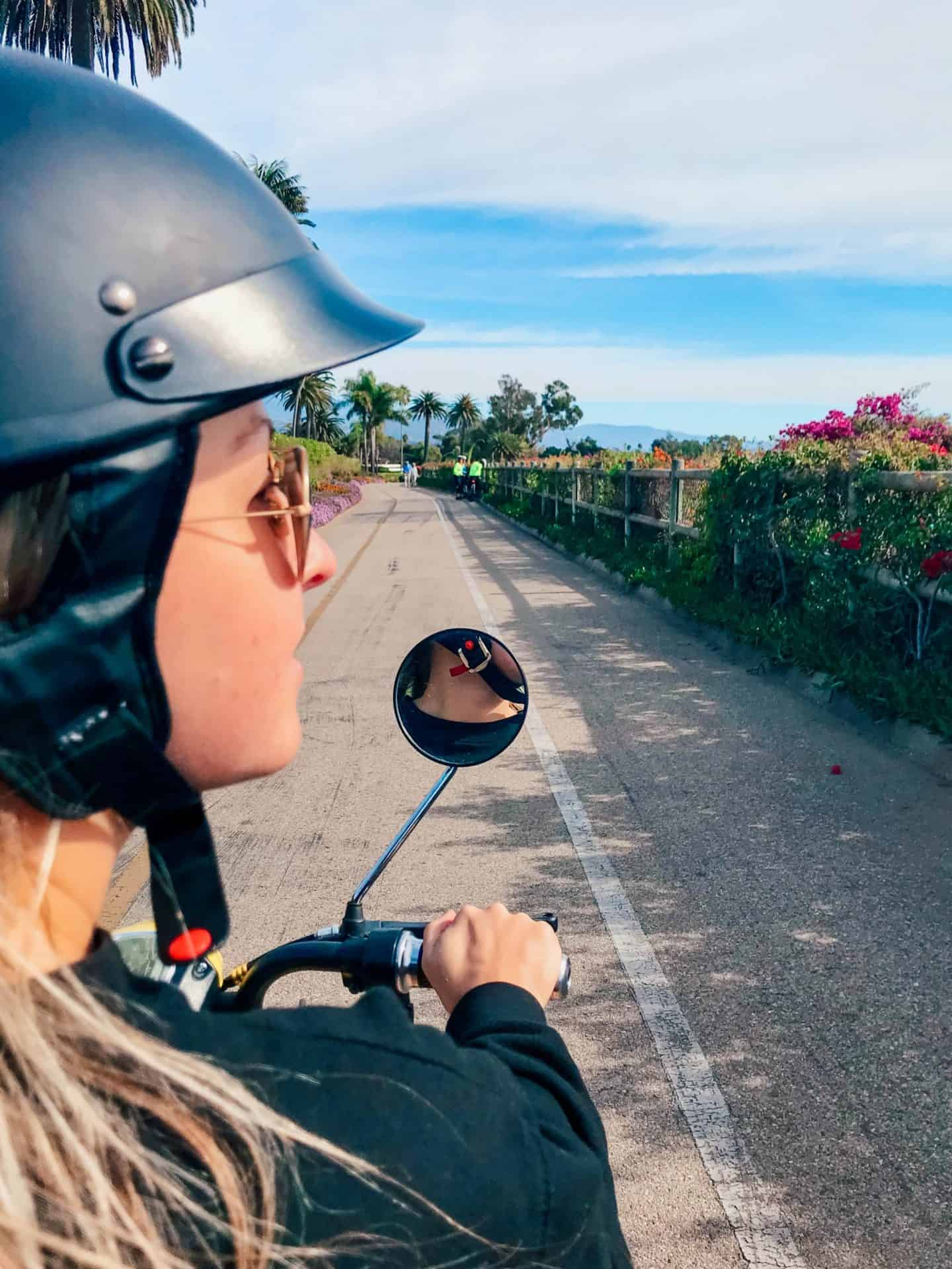 girl driving a moped