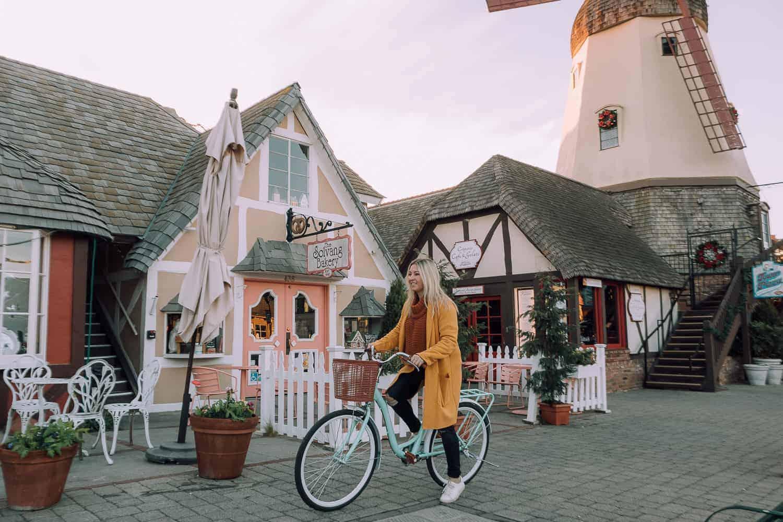 girl riding mint green bike through danish town