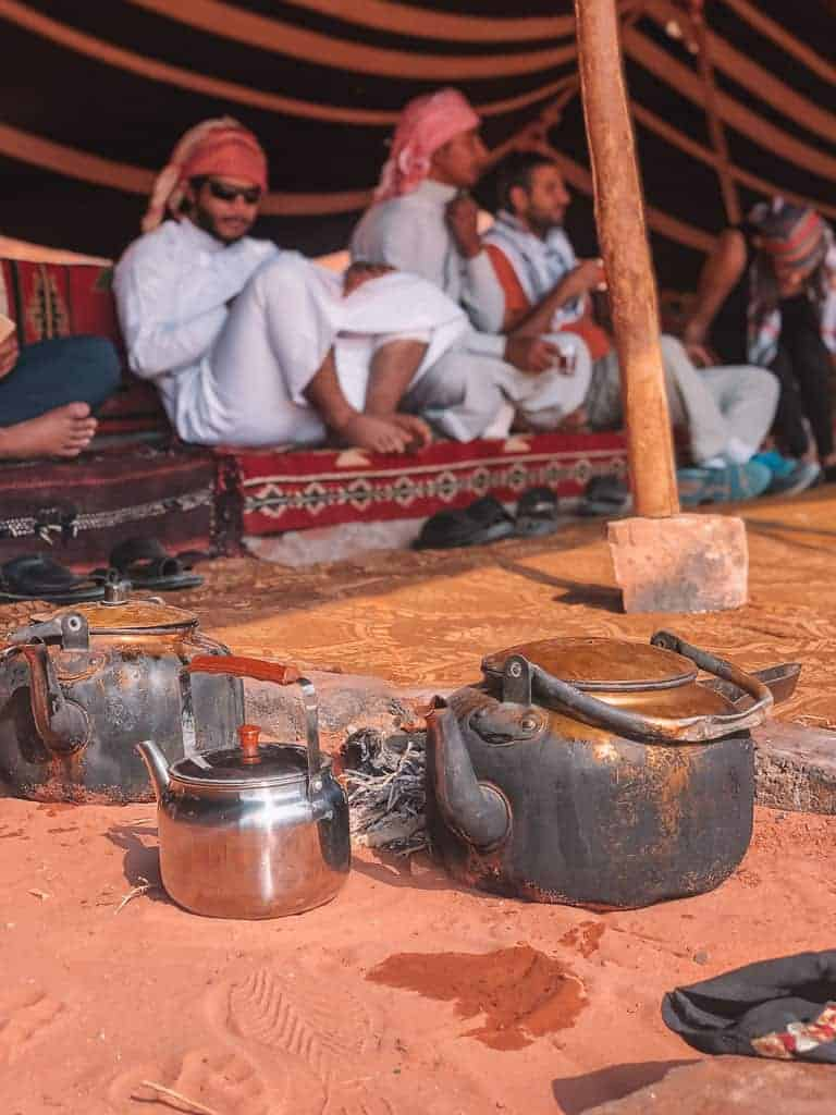 men making tea in the desert