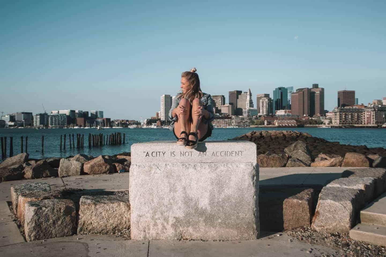 girl in front of boston skyline
