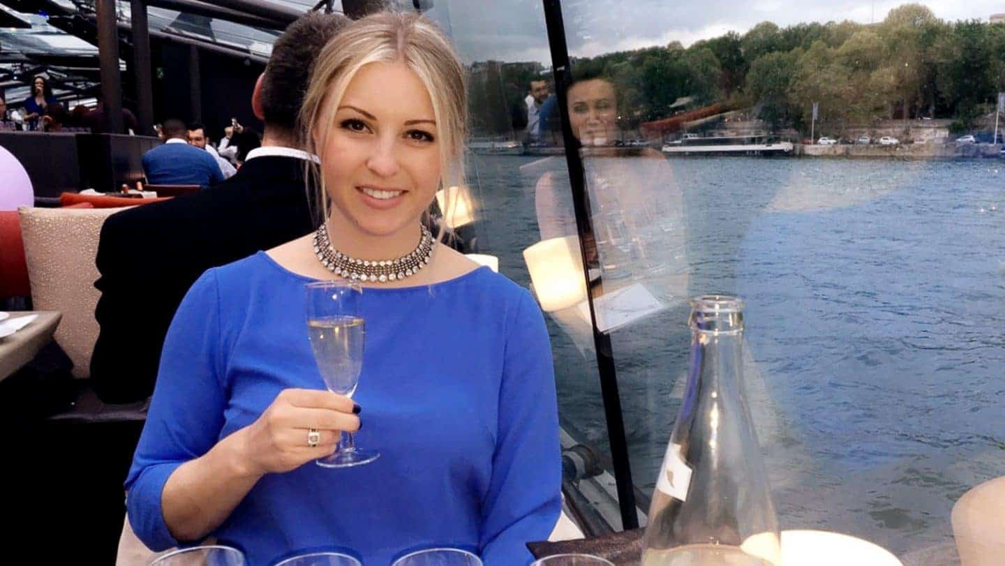 girl on boat drinking champagne