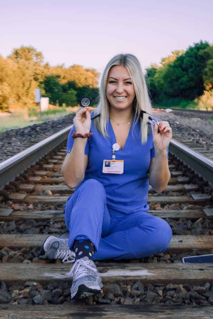 girl in purple scrubs with stethoscope around neck