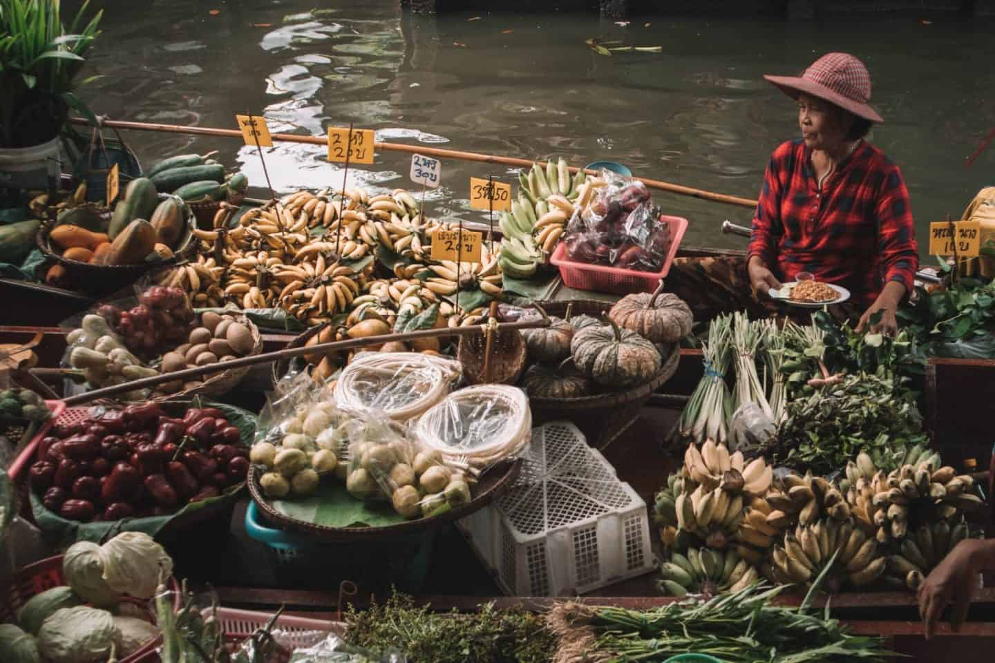 woman with food in boat
