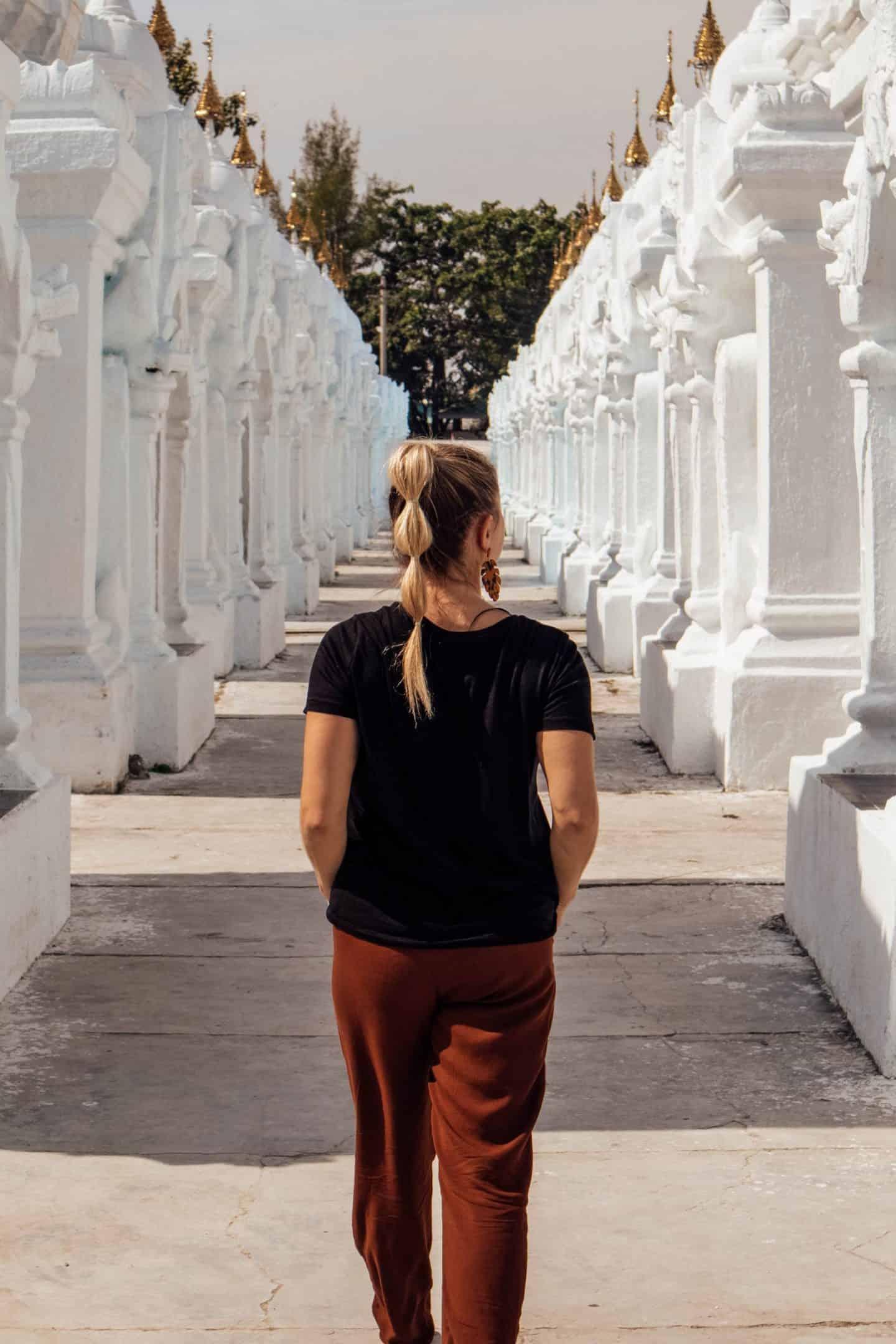 girl walking through ancient pagodas