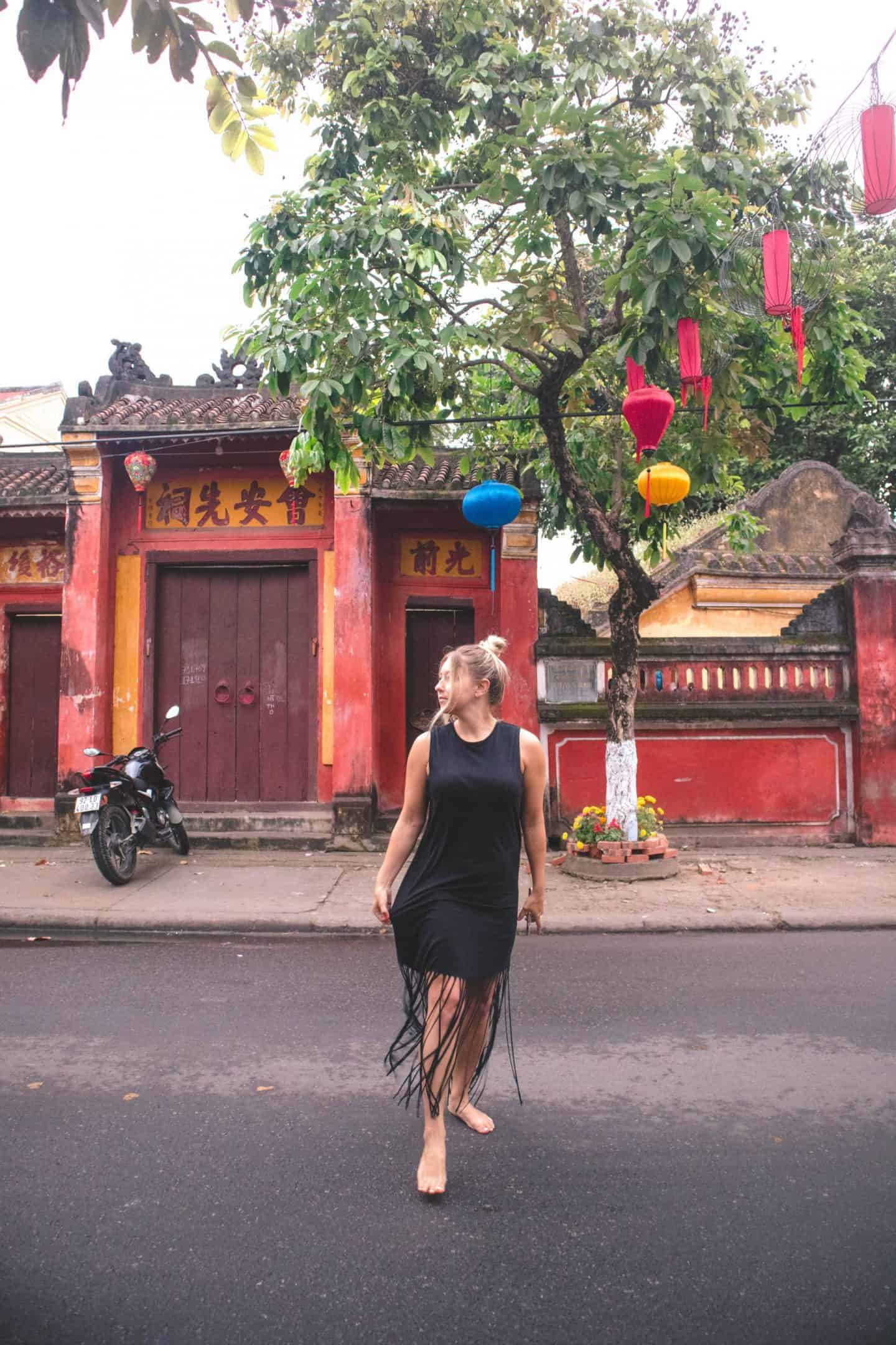 girl barefoot in street with lanterns