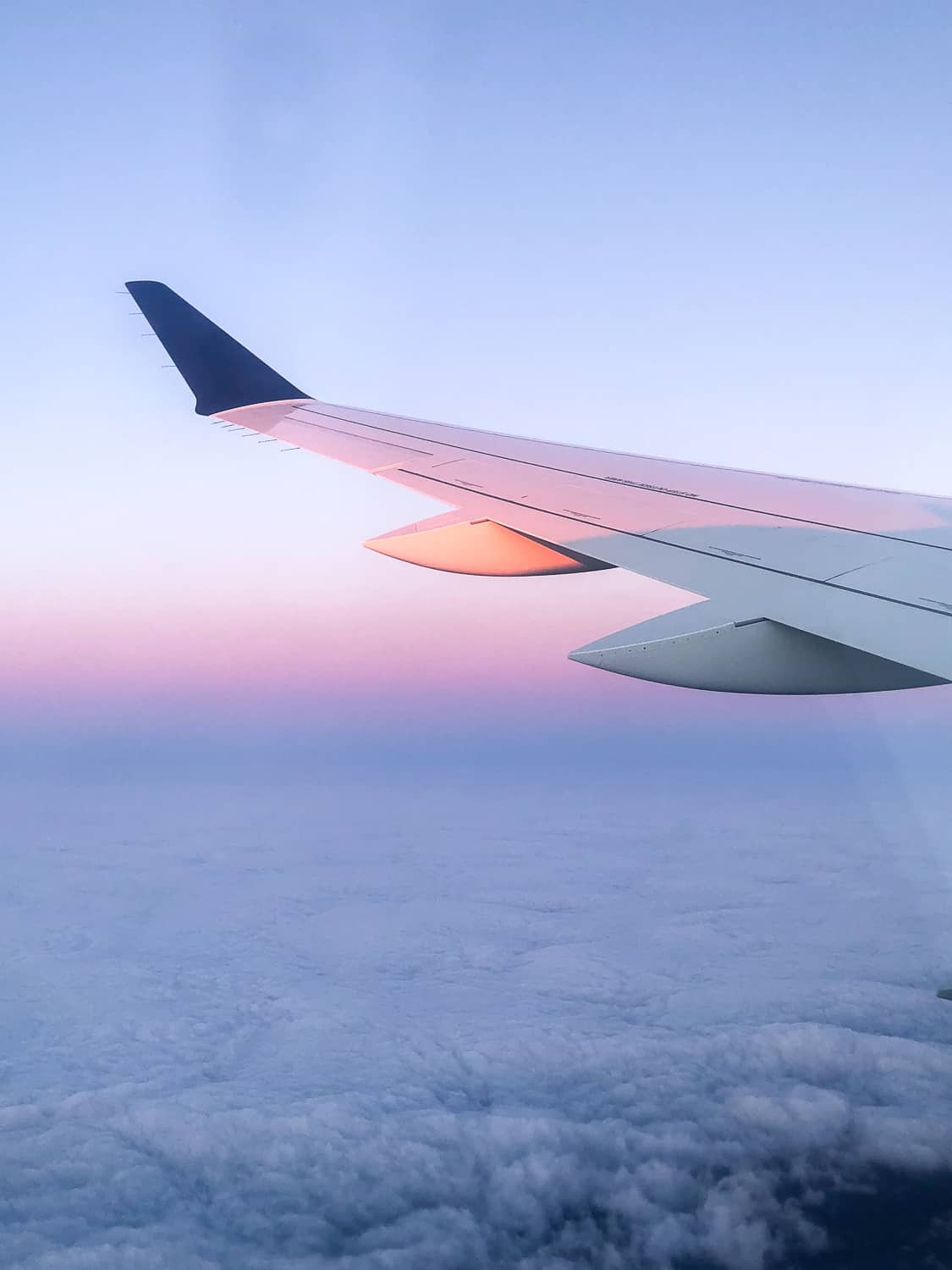 picture of airplane wing with beautiful sunrise
