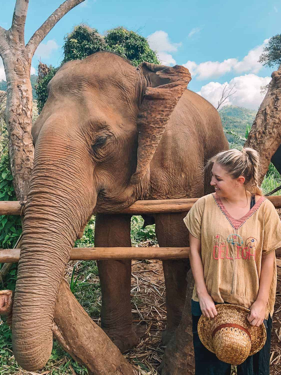 girl with elephant at sanctuary