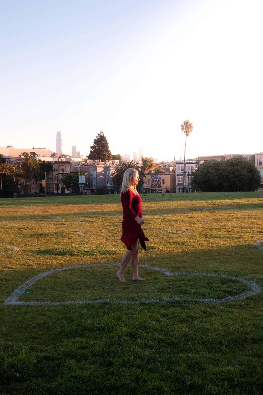 girl twirling in park