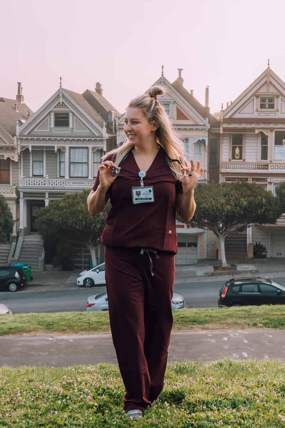 nurse in front of the painted ladies in san francisco