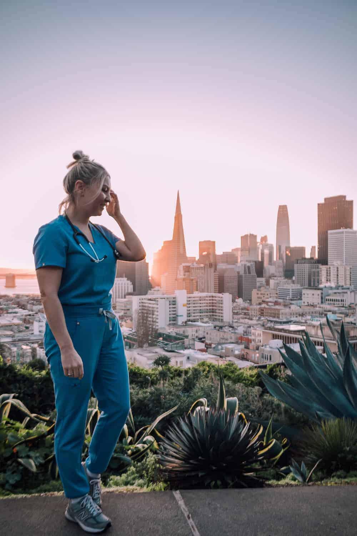 nurse at sunrise with san francisco skyline in backdrop