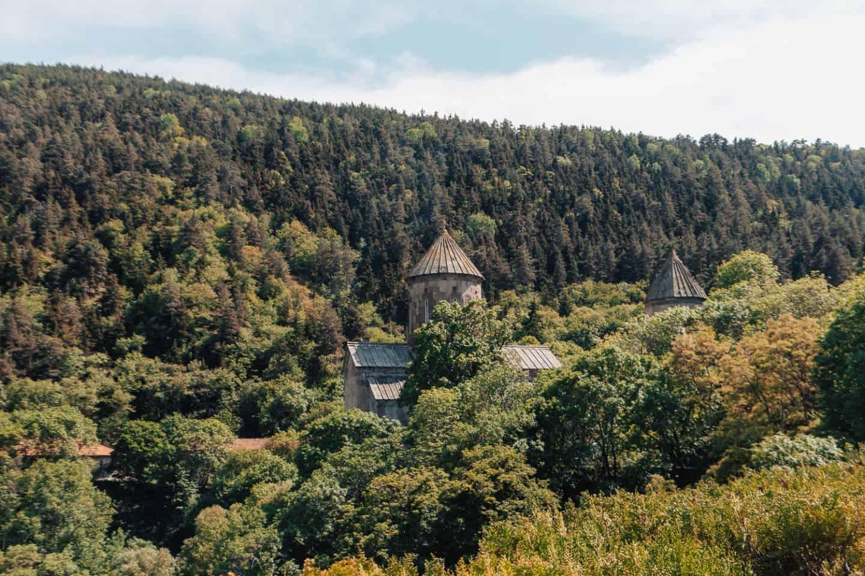 monastery hidden behind the trees