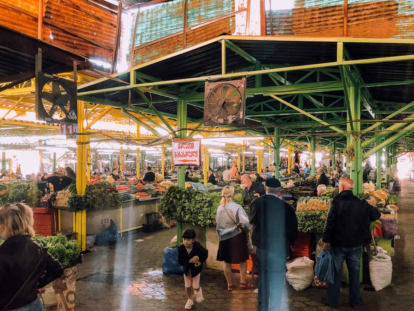 market filled with food and people