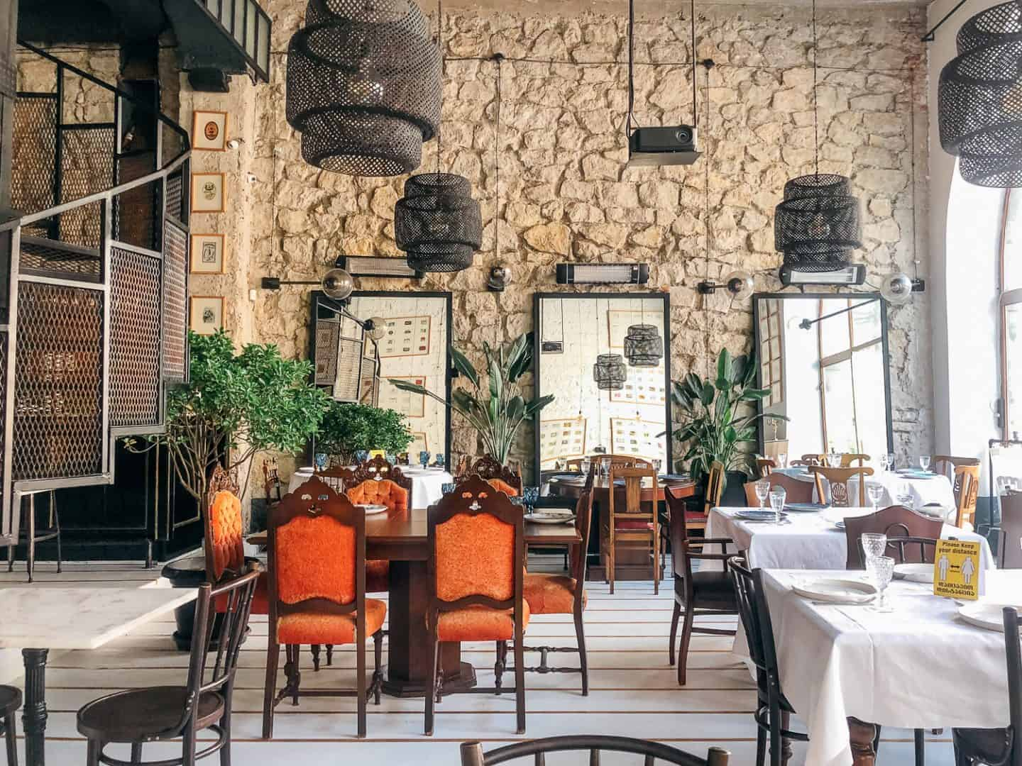 inside of a fancy restaurant with stone and plants