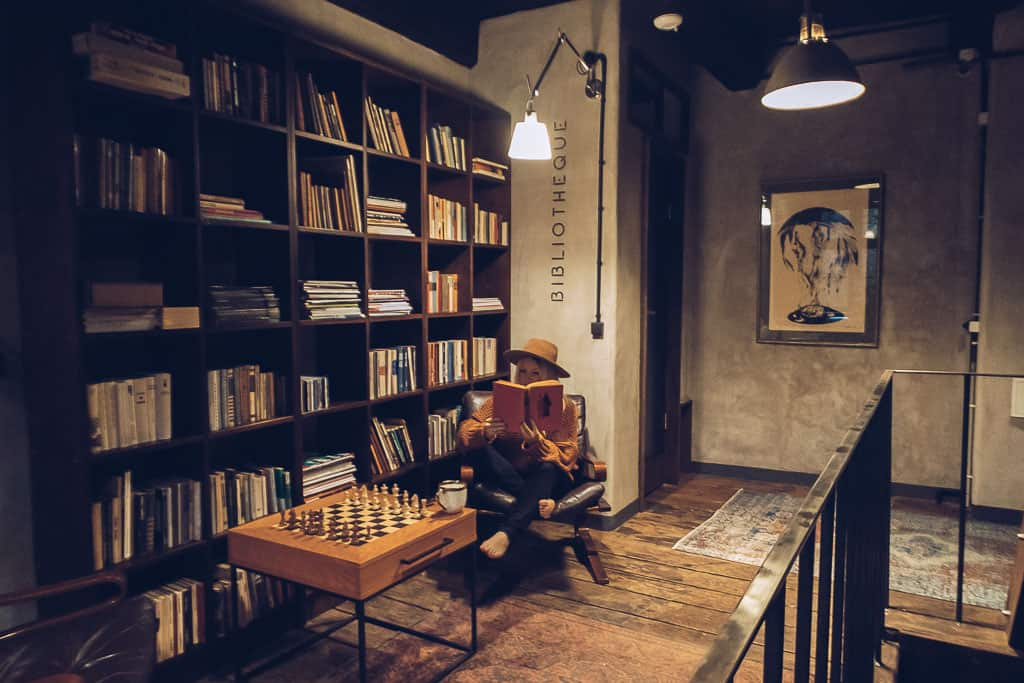 reading books in a swanky hotel