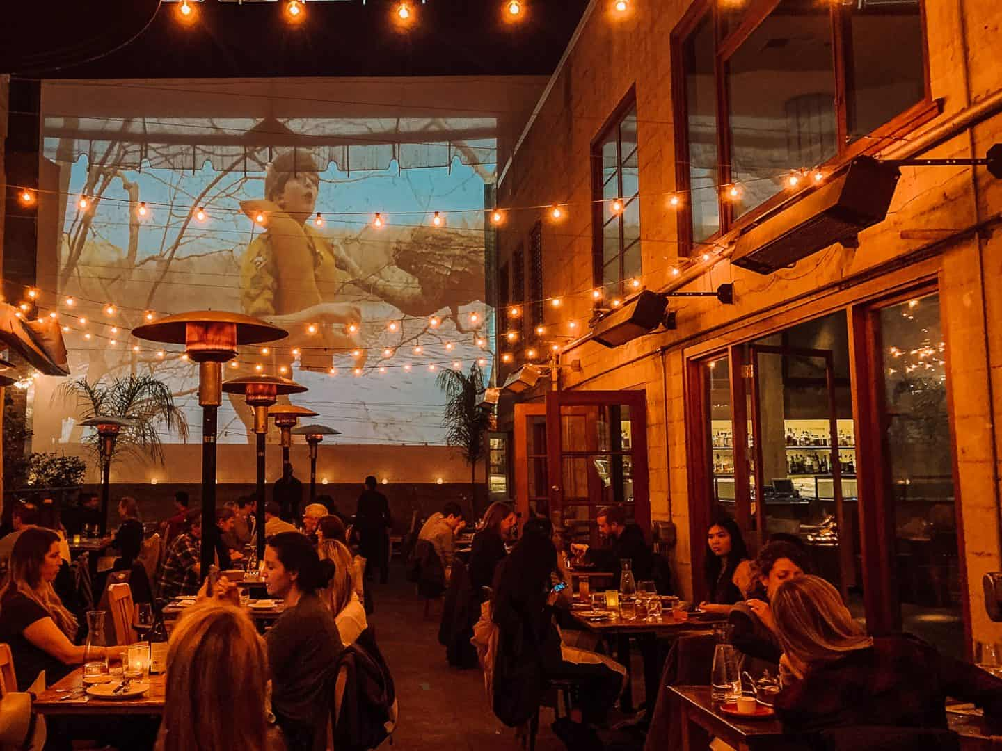 restaurant with movie on the projector