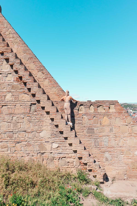 girl standing on zig zag steps
