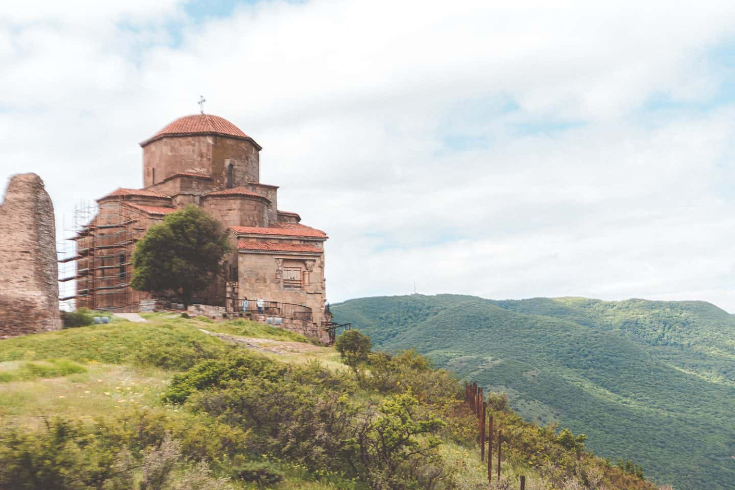 beautiful old monastery up on a green hill