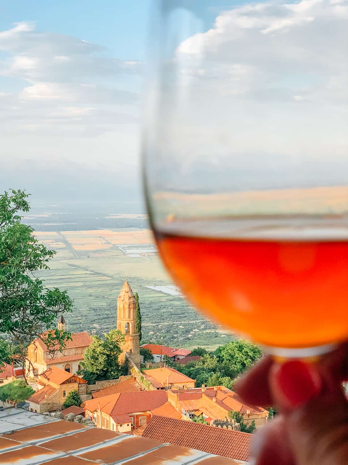 amber wine with a beautiful town in the distance