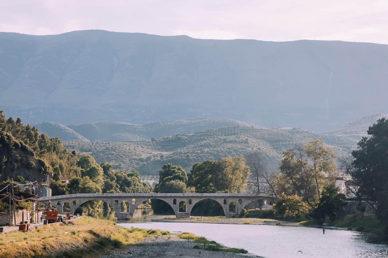 beautiful old bridge against mountain scenery